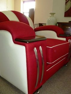 This art deco chair feels appropriate for a retro party basement.  Crimson and cream with a modern, boldly geometric form.