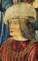reine roi et dauphin.- Louis d'Orléans est déclaré roi de France le 8 avril 1498, sous le nom de Louis XII. La présence de Saint-Louis (Louis IX) dans cette tapisserie est un argument supplémentaire pour reconnaitre Louis XII dans le roi qui accueille la licorne et le pélerin.