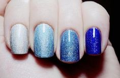 Blue hues Ombre nail art designs. Give a twist to your blue hues with glitter polish. Not only will it give another look to the Ombre design but it also makes each nail stand out on its own.