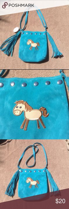 """Turquoise Fringed Sueded Horse Purse This cute purse features a horse appliqué , and fringed detail. Silver studded accents on one side. Can be worn as a shoulder bags, or lengthened to wear as a cross body bag. Velcro closure. Lined in vinyl. Measures 9"""" tall, by 8"""" wide. Super cute!!! LuLu Girls Accessories Bags"""