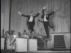 """1943 classic, Stormy Weather, Fayard and Harold Nicholas: the phenomenal Nicholas Brothers Fred Astaire once called this performance """"the greatest dance number ever filmed."""" Mikhail Baryshnikov said, """"Those guys are perfect examples of pure genius. Trailer Peliculas, Mikhail Baryshnikov, Dance Numbers, Dance Movement, Shall We Dance, Dance Routines, Fred Astaire, Best Dance, Tap Dance"""