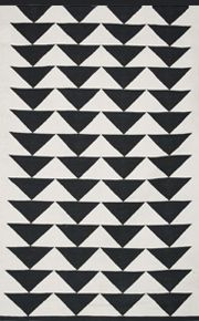 i like this twist on the modern print rugs (zig zags & stripes) that are so popular now...