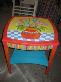 Hand painted table, by Anne Crawley.  I like the stripes on the side