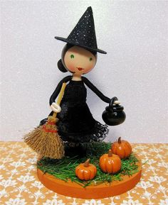 This little witch is very far from frightening! Complete with her broom and cauldron, she poses in a field of pumpkins and is ready to take pride