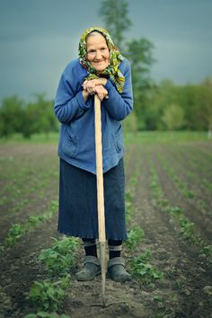 senior lady, garden plot, country living, hoe in hand