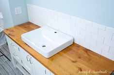 Add rustic warmth to your farmhouse bathroom by adding a waterproof wood vanity top. Learn how to build & protect a wood vanity top for your DIY renovation. Diy Bathroom Vanity, Rustic Bathroom Vanities, Wood Bathroom, Bathroom Furniture, Bathroom Ideas, Master Bathroom, Bathroom Pink, Bathroom Laundry, Basement Bathroom