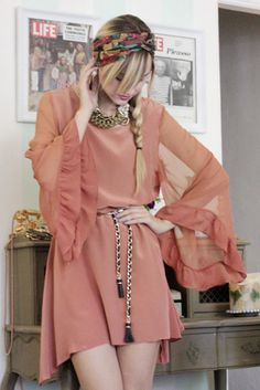 Loving the gold tasked belt and necklace,  and this dress would be gorgeous in a more open peach and pastel colors
