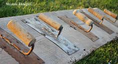 Quirky, cool cement trowel hooks on reclaimed barn wood, by Shizzle Design, featured on I Love That Junk