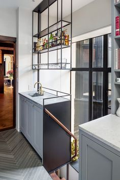 Floating bar above kitchen sink on industrial shelf
