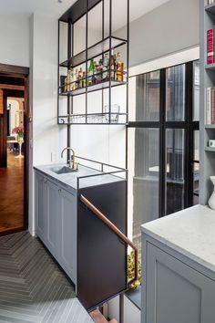 Floating bar above kitchen sink on industrial shelf