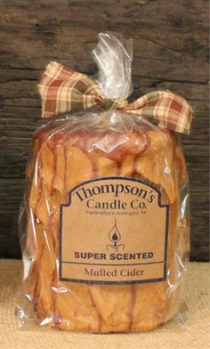 Mulled Cider scented iced pillar candle eaturing the intoxicating scent of apple cider, orange slices, and mulling spices. Made in the USA