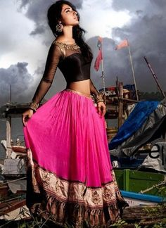 Look Like A Dream Girl In This Chic and Enigmatic Fuchsia & Black Lehenga