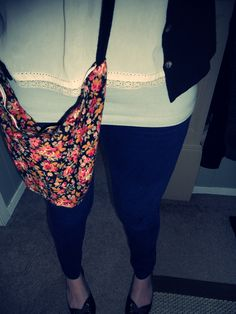 Made this crossbody sack from the sleeve of a thrifted dress, zipper and strap were harvested form other scrap clothing