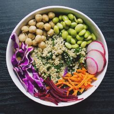 A healthy lunch option of kale, spinach, quinoa, garbanzo beans, edamame, red cabbage, beets,  carrots, and radish. Customize your own blend!