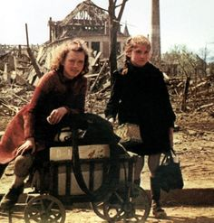 Two girls with a handcart are pausing amid the ruins of the city. July More than 300 bombardments by the British Royal Air Force (RAF) and the United States Army Air Forces took place in the period from June 1940 to the end of the war in Berlin, Germany. Women In History, British History, Otto Von Bismarck, The Third Reich, United States Army, History Photos, Royal Air Force, Two Girls, World War Two