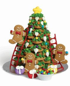 Wilton Tree of Wonder. Gingerbread men decorating a #Christmas tree, how cute.