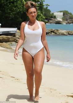 Looking good: Lauren Goodger shows off her hourglass figure as she pads across the sand during her current stay in Malibu