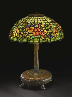 "Lot | Sotheby's  A NEW YORK COLLECTOR TIFFANY STUDIOS ""PANSY"" TABLE LAMP shade impressed TIFFANY STUDIOS/NEW YORK base impressed S1132 and 1 leaded glass and patinated bronze 21  3/8  in. (54.3 cm) high 16  1/8  in. (41 cm) diameter of shade circa 1910 Estimate 30,000 — 50,000 USD  LOT SOLD. 37,500 USD  (Hammer Price with Buyer's Premium)"