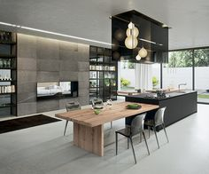 AK_04 kitchen by Italian manufacturer, Arrital. First there is the harmonic balance between man made materials with clear finished wood veneers,