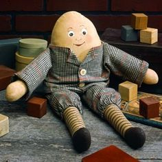 """Mr. Humpty Dumpty Doll Sewing ePattern - Capturing the look of an heirloom toy, this Humpty Dumpty has a special charm all his own. A slightly crooked head and a whimsical smile add to his appeal. With his coffee-dyed body and clothes, one would ever guess that he has not been passed down from several generations of loving children. Dressed in shirt and pants, Humpty Dumpty will be an instant """"antique"""" for your toy collection. His facial features and shoes are added using markers and paint…"""
