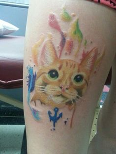 Adorable watercolor cat tattoo on thigh leg for woman