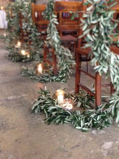 Olive garland pew ends for a Christmas Wedding . Red Eden and Olive