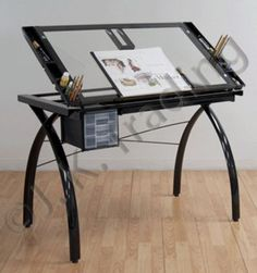 Draft, draw or craft anytime with Studio Designs' Futura Craft Station. Featuring tempered safety-glass with a large surface, this multifunctional table lets you craft with ease. Heavy-gauge, powder-coated inches wide x 24 inches deep x inches high Bureau D'art, Wood Drafting Table, Jigsaw Puzzle Table, Table Reglable, Art Tables, Dining Room Table, Drawing Desk, Craft Station, Solid Wood Desk