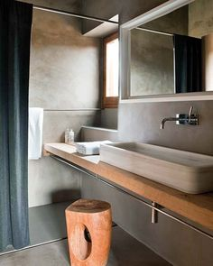 Interesting idea for a small space. Continue the floating countertop right into the shower area to hold shampoo's etc. Of course a water appropriate material would have to be used, teak, or tile would work.
