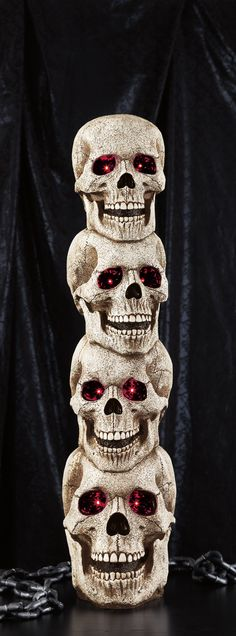 Garnish your ghoulish Halloween décor with the Stacked Skulls with Sound. Four grinning skulls stacked 41 inches high provide chills with their red LED eyes. Features spooky, motion-activated lights and sound with volume control and a stand for added stability.