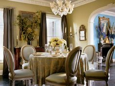 A skirted table and opulent silk curtains set off important antiques in Eric Prokesh's Dallas dining room. (Photo: Photo: Pieter Estersohn; Designer: Eric Prokesh)
