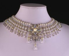 This Exquisite piece of jewelry was handmade with the inspirations of the 1920's You can tell by looking at the design, it's complexity and dedication.  This bridal choker features Swarovski pearls an