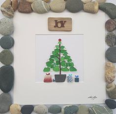Made to order. Please message me with your requirements. A beautiful and unique handmade pebble art picture wonderful green sea glass Christmas tree with sea pottery Christmas presents under the tree. You can purchase this pebble piece with or without a Christmas sign or message. Please let me know which sign you would like and where on the picture you would like the sign placed (above or below) If you would like your own message included onto picture I can include printed quotes or…