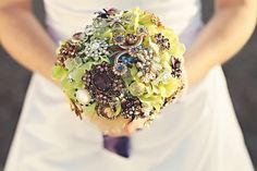 this is the brooch bouquet that my mom made out of family jewelry for my wedding!