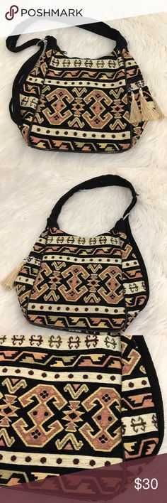 Aztec Boho Fringe Evil Eye Purse Tan & Black Great Boho Festival hippie bag! Unique Aztec/ tribal print with fringe and evil eye beads. Unique Strap that can be made a double strap or zippered together. Some wear on the bottom edge and the strap loop otherwise in great condition. Length 8.5 inches, width 6.5 inches, height 10 inches Bags Satchels