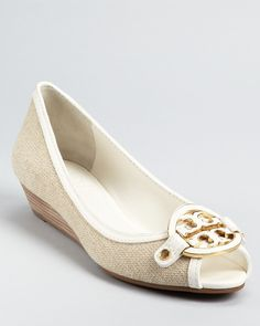 When you need to give your Reva flats a break, we love Tory Burch's Amanda Demi Wedges as a fresh spring option.