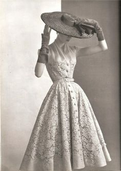 This is a modern shirtwaist dress by Balmain. The shirtwaist dress was popular among women in the 1900's because it represented independence and was comfortable to wear to work.