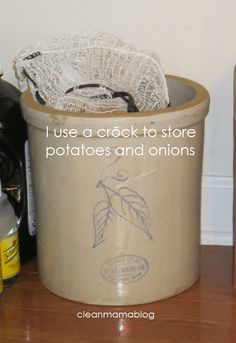 Using a crock to store onions and potatoes provides a dark dry space -Kitchen Month – Pantry Organization