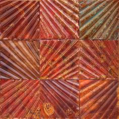 These metal wall tiles have some great colors in them.