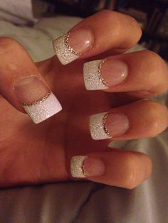 Glitter white acrylic tips with silver accent minus the square nails, almond shape