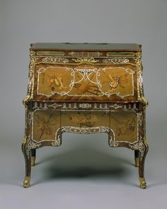 Roll-top Desk by Abraham and David Roentgen (closed) circa 1765-1770 on display in the French Drawing Room