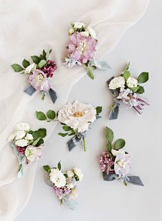 wedding boutonnieres Boutonnières by Bows + Arrows Flowers included delphiniums, lilacs, clematis, and garden roses, tied 