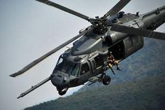 Members of the 33rd Rescue Squadron fly a Pave Hawk at Osan Air Base, South Korea.