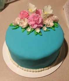 My Wilton Course 3 final cake.  This is a white almond cake with strawberry preserve filling.  The cake was with fondant and fondant flowers and border.