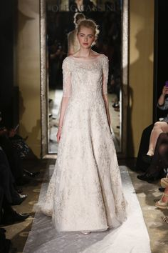 Ivory lace embroidery and three quarter illusion sleeves from Oleg Cassini {photo: Dan Lecca}