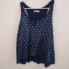 Abercrombie Tank Navy blue and white polka dot tank top from Abercrombie. Has an easy, flowy fit and three buttons at the neckline. Looks great with shorts in the summer! Gently worn but in great condition! 15% off all bundles!  Abercrombie & Fitch Tops Tank Tops