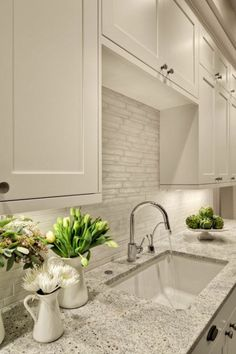 Granite countertop with sink and matching above cabinets in white