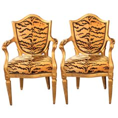 Pair of gilt chairs | From a unique collection of antique and modern armchairs at http://www.1stdibs.com/furniture/seating/armchairs/