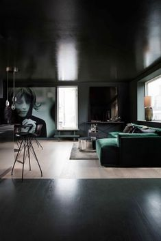 A private Penthouse in Copenhagen by Rue Verte I green sofa I large wall photo