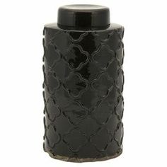 """Create an eye-catching focal point on your mantel or coffee table with this elegant lidded jar, crafted of terracotta and featuring a quatrefoil design.  Product: Lidded jarConstruction Material: TerracottaColor: Black Features: Glazed finishDimensions: Small: 7.75"""" H x 5.75"""" DiameterLarge: 12.25"""" H x 6.5"""" Diameter"""