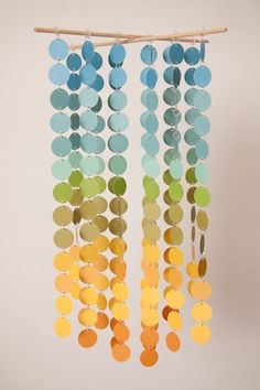 Mobile made from paint chips - I like this idea for one of those curtain-like things to put in a doorway.